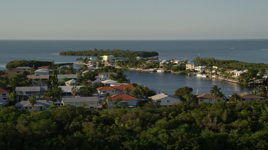 5K stock footage aerial video of flying by homes near the shore, Marathon, Florida Aerial Stock Footage | AX0028_001
