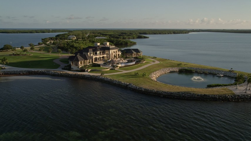 5K stock footage aerial video of orbiting a mansion on the shore, Marathon, Florida Aerial Stock Footage | AX0028_005