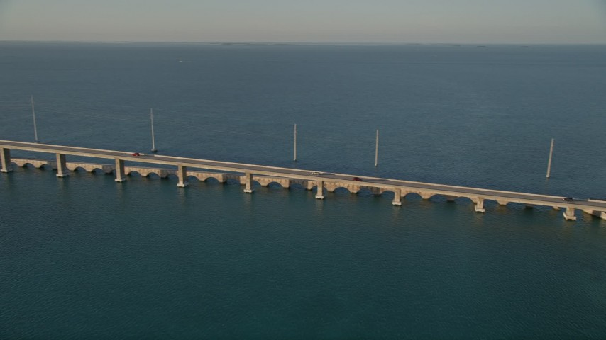 5K stock footage aerial video of tracking light traffic on Overseas Highway bridge at sunset, Craig Key, Florida Aerial Stock Footage | AX0028_021