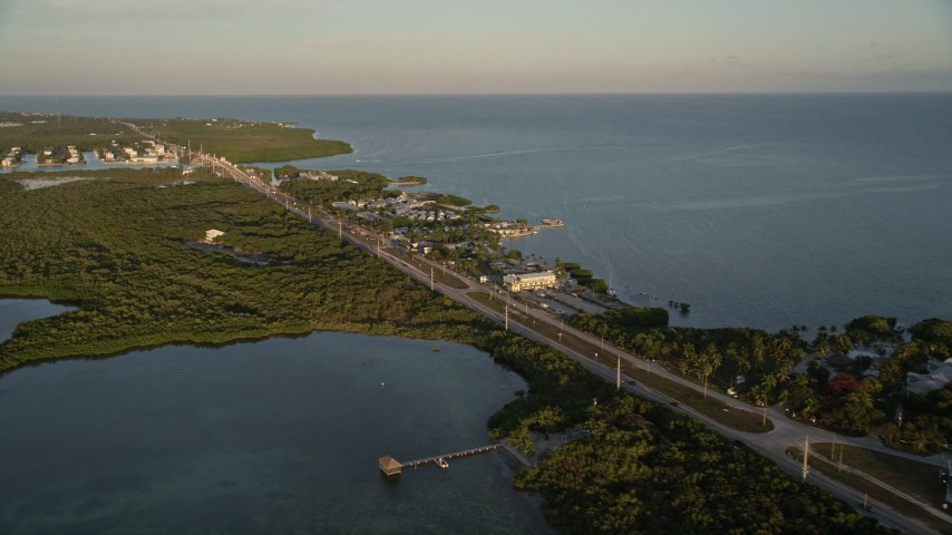 5K stock footage aerial video of Overseas Highway by Drop Anchor Resort and Marina, Islamorada, Florida, at sunset Aerial Stock Footage | AX0028_023