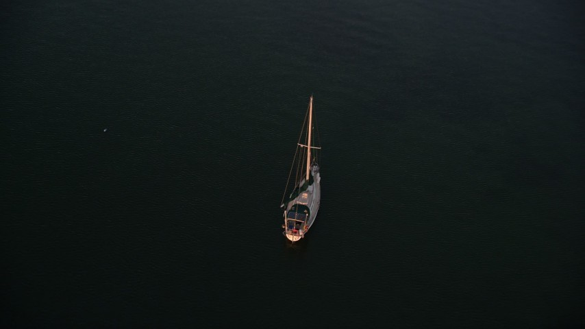 5K stock footage aerial video of approaching sailboat at sunset, Key Largo, Florida Aerial Stock Footage | AX0028_035