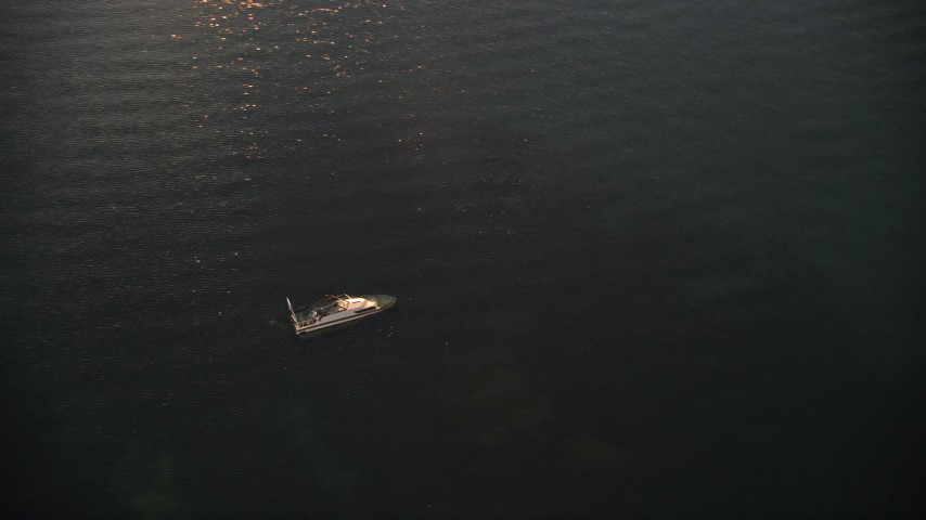5K stock footage aerial video of orbiting a sunken speedboat at sunset, Key Largo, Florida Aerial Stock Footage | AX0028_036