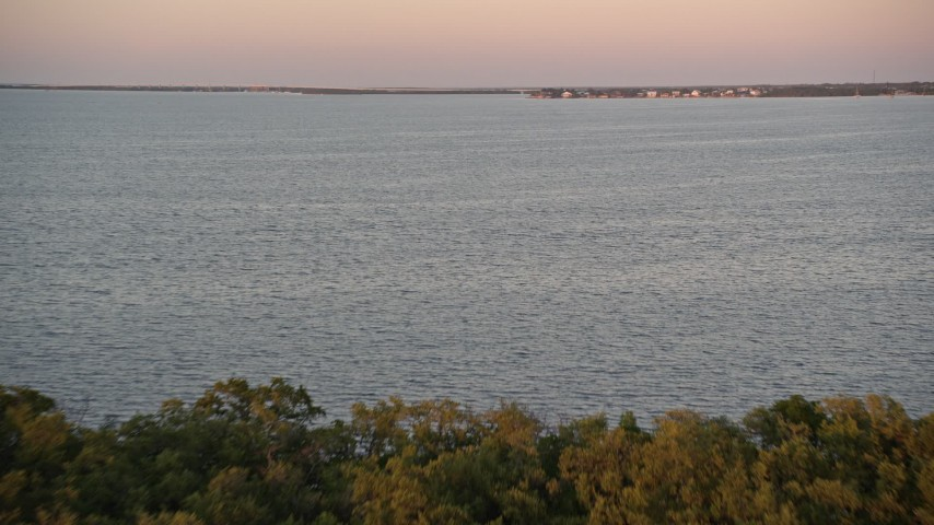 5K stock footage aerial video of flying over mangroves and a bay at sunset, Key Largo, Florida Aerial Stock Footage   AX0028_041