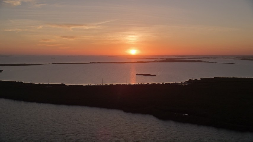 5K stock footage aerial video of flying by bays and mangroves, Key Largo, Florida, sunset Aerial Stock Footage | AX0028_042