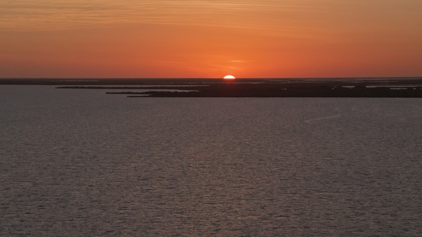5K stock footage aerial video of ascending over the water, Key Largo, Florida, sunset Aerial Stock Footage | AX0028_047