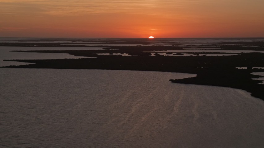 5K stock footage aerial video of flying by mangroves and bays, Key Largo, Florida, sunset Aerial Stock Footage | AX0028_048
