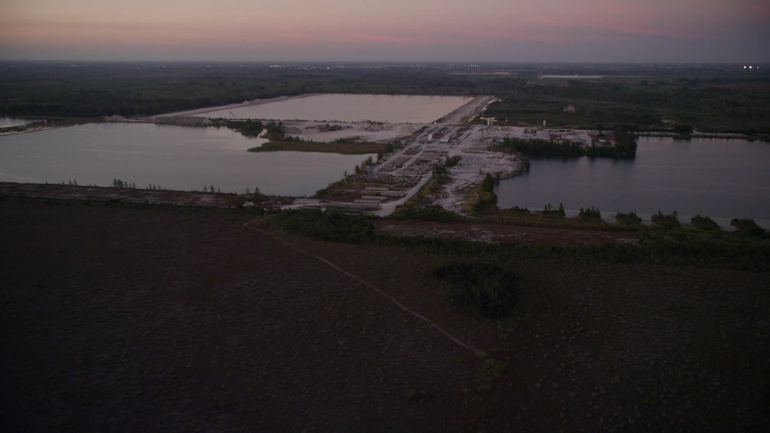 5K stock footage aerial video of approaching quarry, Homestead, Florida, twilight Aerial Stock Footage | AX0028_060