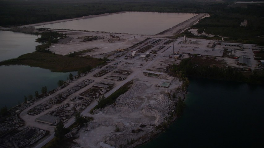 5K stock footage aerial video of flying over quarry, Homestead, Florida, twilight Aerial Stock Footage | AX0028_061