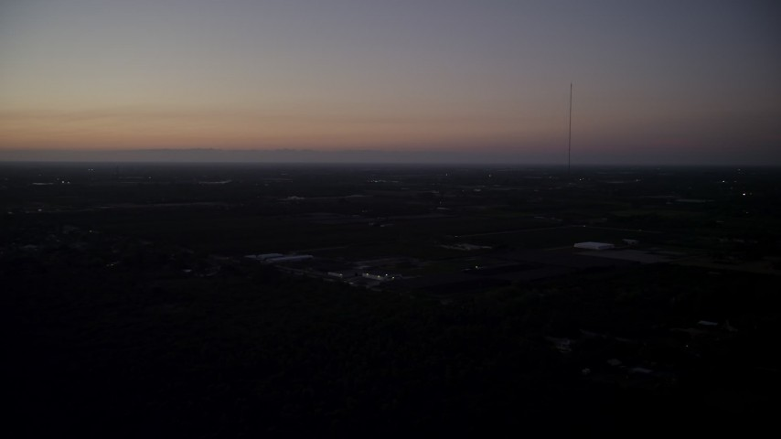 5K aerial  video of flying by Homestead, with coastline in distance, Homestead, Florida, twilight Aerial Stock Footage | AX0028_063