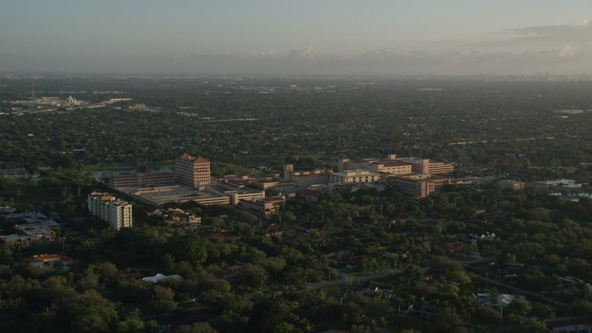 5K stock footage aerial video of flying by Baptist Hospital of Miami,  Kendall, Florida, sunrise