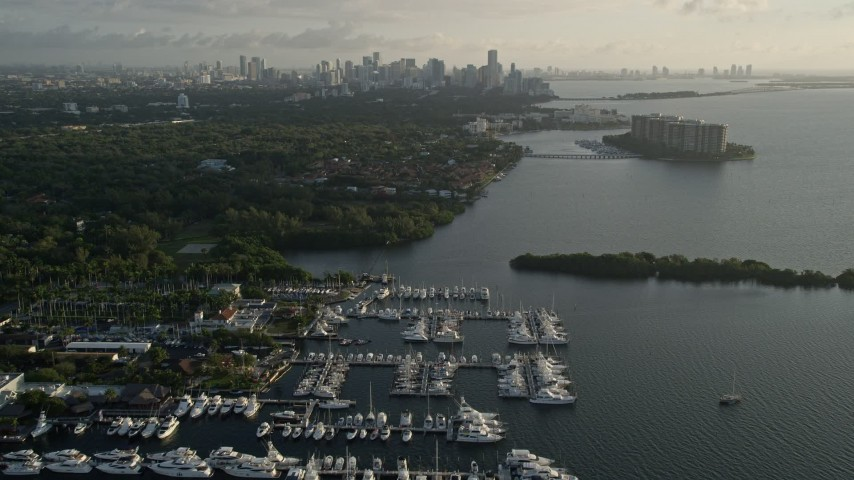 5K aerial video fly over marinas, Downtown Miami skyline, Coconut Grove, Florida, sunrise Aerial Stock Footage | AX0029_007