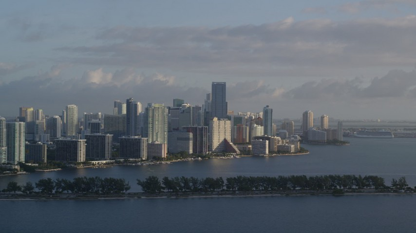 5K stock footage aerial video of flying by Downtown Miami skyline, Florida, sunrise Aerial Stock Footage | AX0029_009