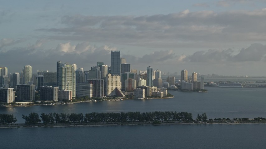 5K stock footage aerial video of flying by Downtown Miami skyline, Florida, sunrise Aerial Stock Footage | AX0029_009E