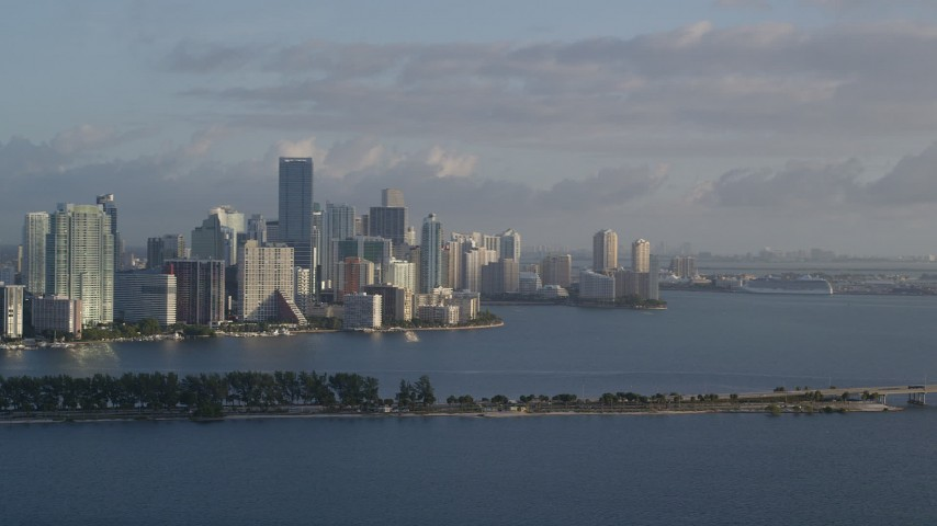 5K stock footage aerial video of flying by Downtown Miami skyline, Florida, sunrise Aerial Stock Footage | AX0029_010