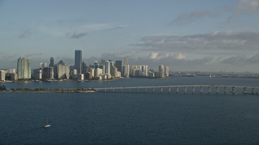 5K aerial video of downtown skyline, Rickenbacker Causeway bridge, Miami, Florida, sunrise Aerial Stock Footage | AX0029_011