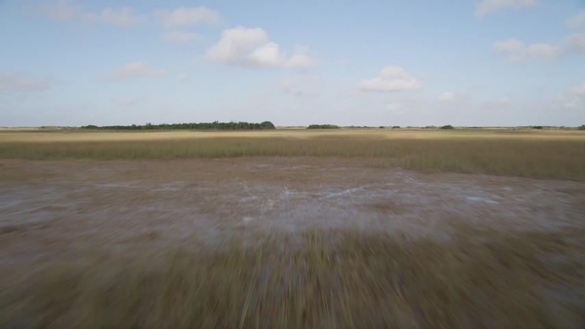 5K stock footage aerial video of marshland, Florida Everglades, Florida Aerial Stock Footage   AX0030_027