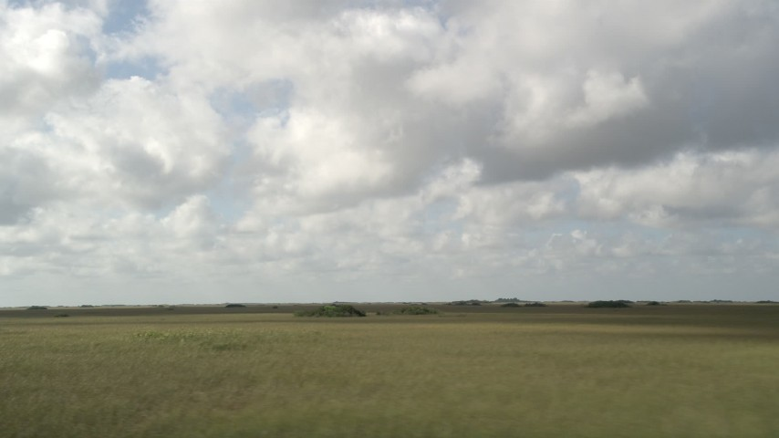 5K stock footage aerial video of flying by low clouds over the marshland, Florida Everglades, Florida Aerial Stock Footage | AX0030_095