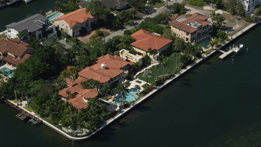 5K stock footage aerial video of a mansion by a canal, Coral Gables, Florida Aerial Stock Footage | AX0031_013