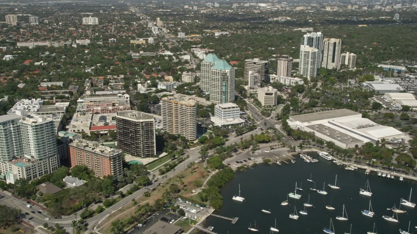 5K stock footage aerial video of flying by office buildings, Coconut Grove, Florida Aerial Stock Footage | AX0031_015
