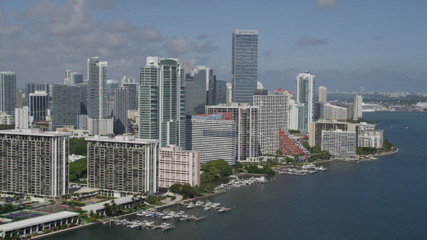 5K stock footage aerial video of flying by Downtown buildings on the shore, Miami, Florida Aerial Stock Footage | AX0031_020