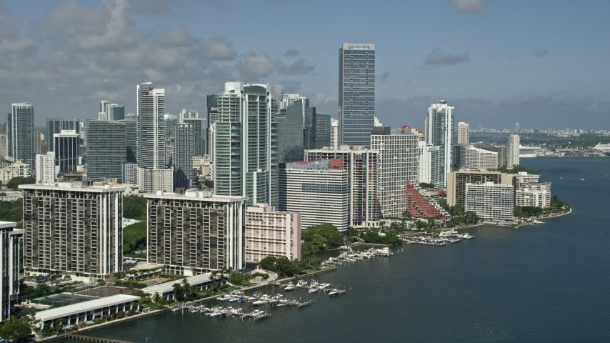 5K stock footage aerial video of flying by condo complexes near the Four Seasons on the shore, Miami, Florida Aerial Stock Footage   AX0031_020E