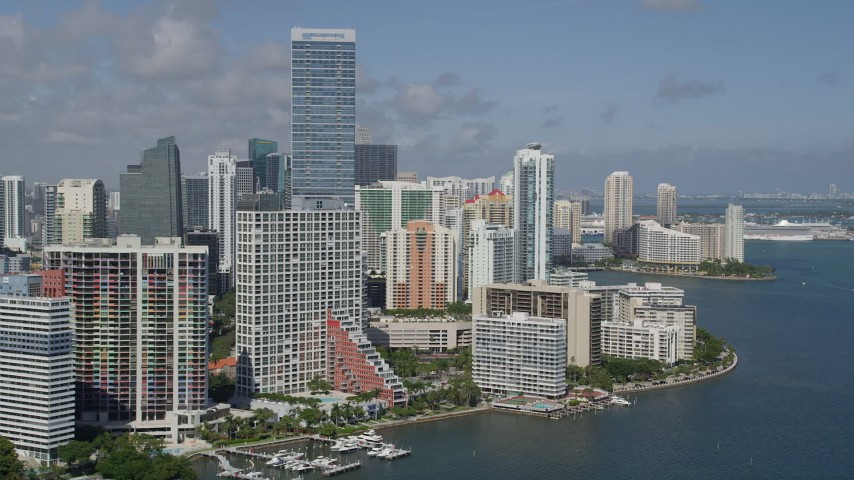 5K stock footage aerial video of following the shore of Biscayne Bay, by apartments and hotels, Miami, Florida Aerial Stock Footage | AX0031_021