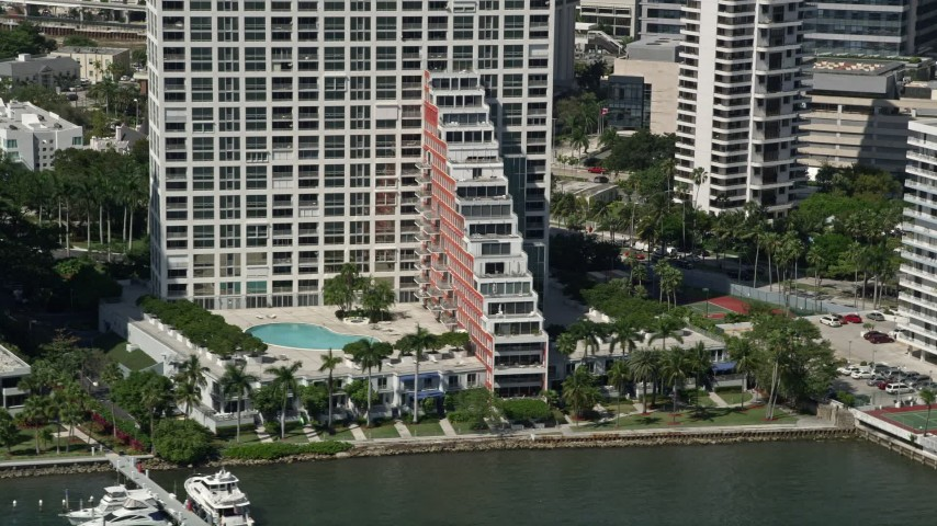 5K stock footage aerial video of an apartment building on the shore of Biscayne Bay, Miami, Florida Aerial Stock Footage | AX0031_022