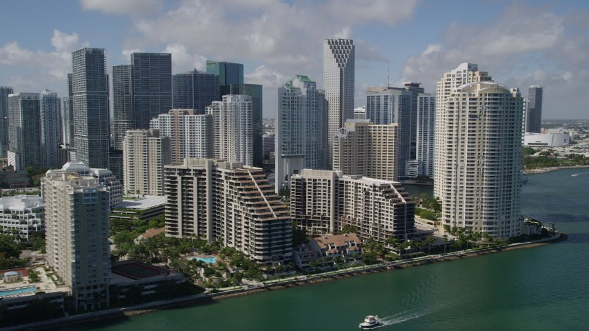 5K stock footage aerial video of flying by Brickell Key, Downtown Miami skyscrapers, Miami, Florida Aerial Stock Footage | AX0031_025