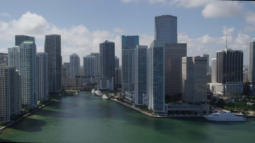 5K stock footage aerial video of flying by skyscrapers on Brickell Key, reveal Miami River, Downtown Miami, Florida Aerial Stock Footage | AX0031_026