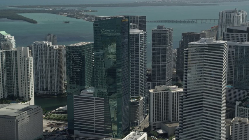5K stock footage aerial video of flying by Wells Fargo Center, downtown buildings and skyscrapers, Downtown Miami, Florida Aerial Stock Footage | AX0031_029