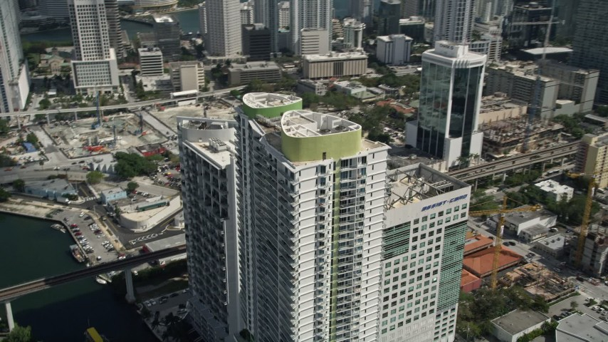 5K stock footage aerial video of Latitude on the River skyscraper, Downtown Miami, Florida Aerial Stock Footage | AX0031_031