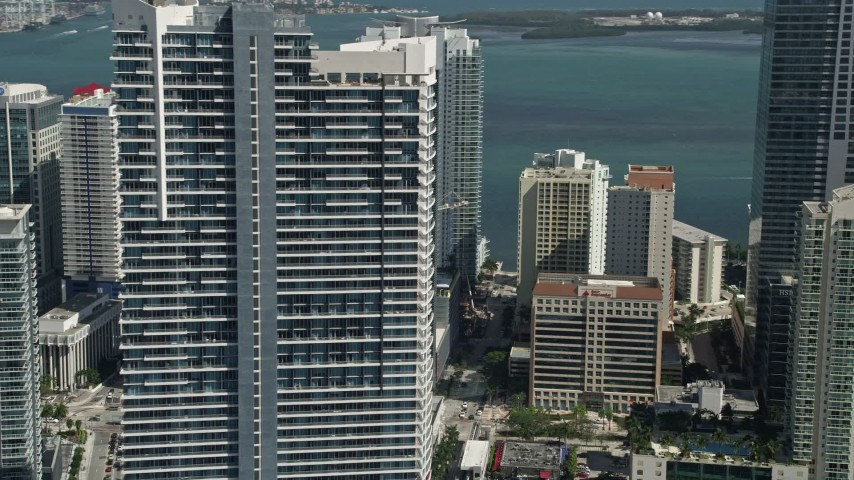 5K stock footage aerial video of flying by Infinity at Brickell, revealing Espirito Santo Plaza, Downtown Miami, Florida Aerial Stock Footage | AX0031_032