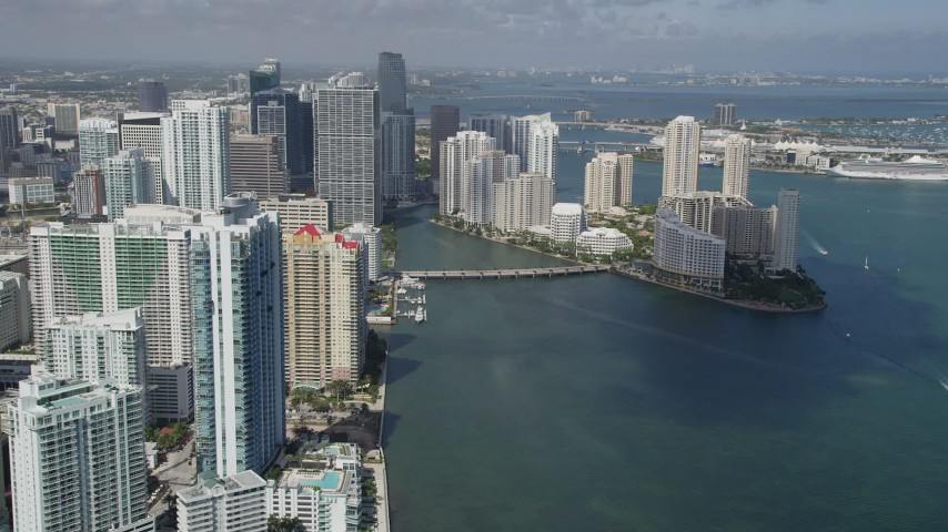 5K stock footage aerial video of flying by downtown buildings and skyscrapers and Brickell Key, Downtown Miami, Florida Aerial Stock Footage | AX0031_034
