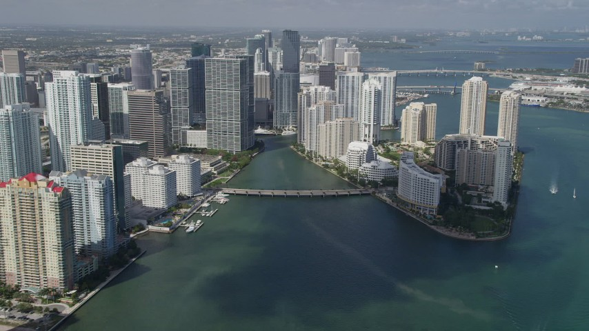 5K stock footage aerial video of flying by Downtown Miami buildings and skyscrapers, Downtown Miami, Florida Aerial Stock Footage | AX0031_035