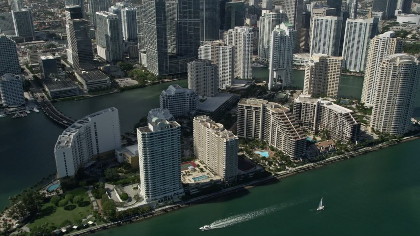 5K stock footage aerial video of flying by skyscrapers and Mandarin Oriental on Brickell Key, Downtown Miami, Florida Aerial Stock Footage | AX0031_036