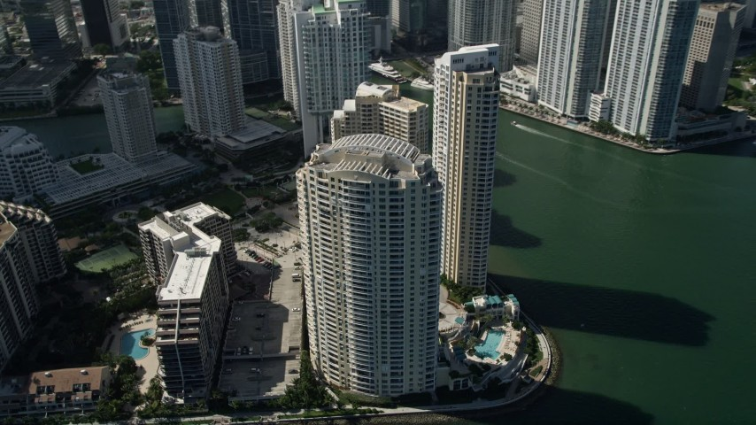 5K stock footage aerial video of flying by skyscrapers on the shore of Brickell Key, Downtown Miami, Florida Aerial Stock Footage | AX0031_037