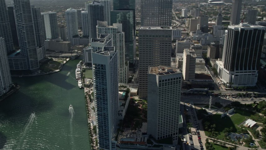 5K stock footage aerial video fly by skyscrapers, InterContinental Miami hotel, Miami River, Downtown Miami, Florida Aerial Stock Footage | AX0031_038