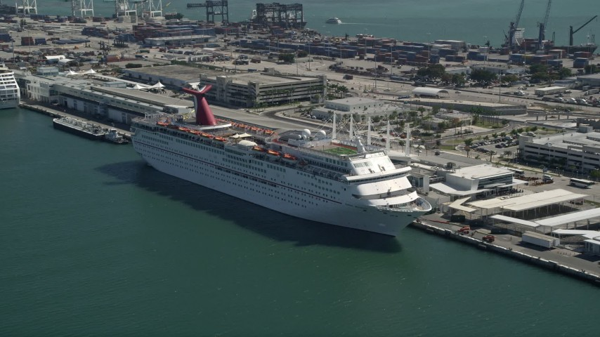 5K stock footage aerial video of flying by a Carnival Cruise Ship at Port of Miami, Florida Aerial Stock Footage | AX0031_041