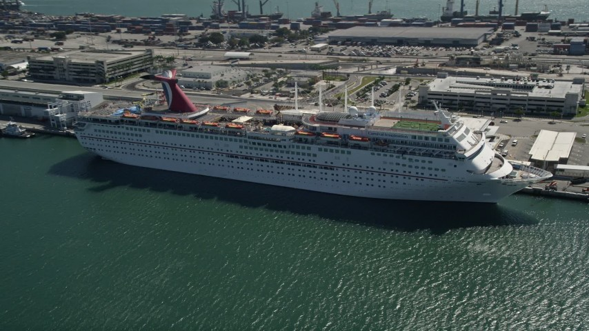 5K stock footage aerial video of a Carnival Cruise Ship at Port of Miami, Florida Aerial Stock Footage | AX0031_042