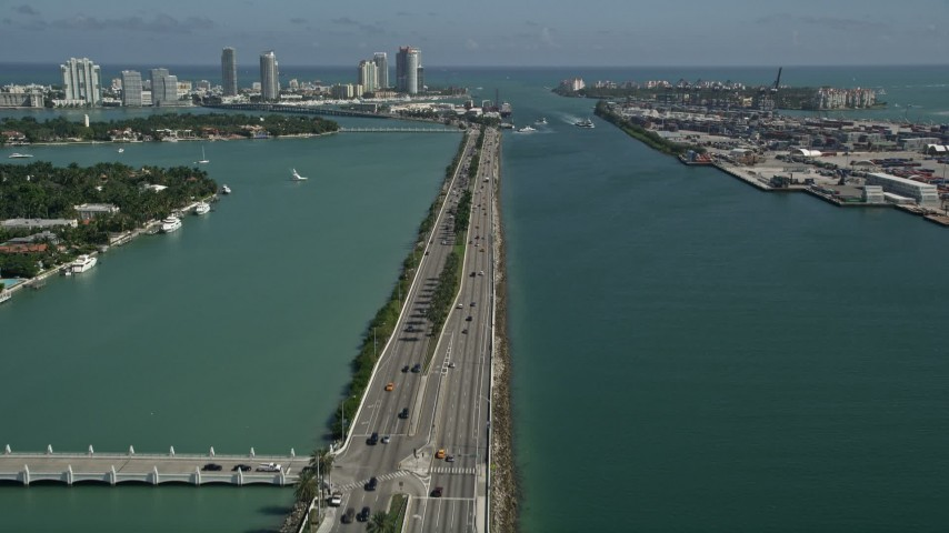 5K stock footage aerial video of flying over MacArthur Causeway, revealing South Beach, Miami Beach, Florida Aerial Stock Footage | AX0031_043