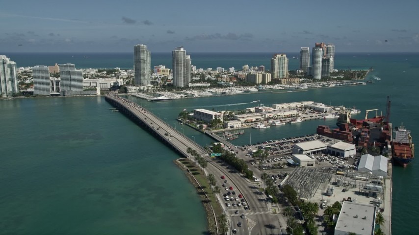 5K stock footage aerial video of flying over MacArthur Causeway, revealing South Beach, Miami Beach, Florida Aerial Stock Footage | AX0031_046