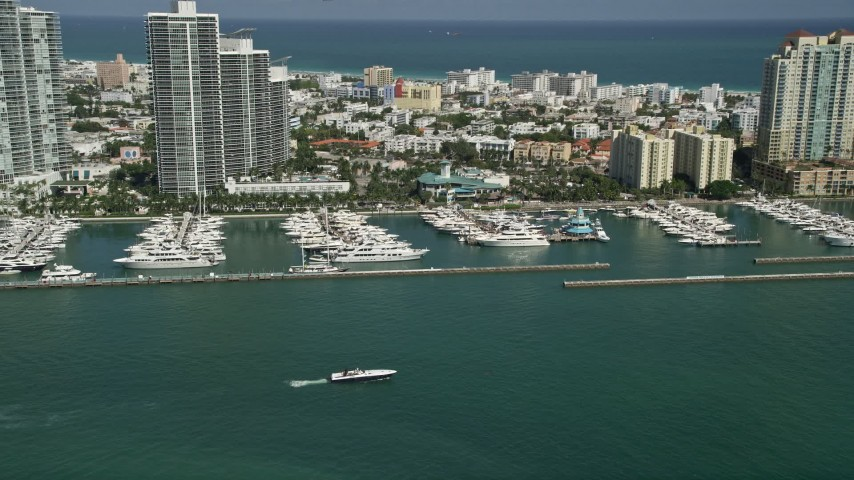 5K stock footage aerial video of flying by yachts docked at Miami Beach Marina, South Beach, Florida Aerial Stock Footage | AX0031_047