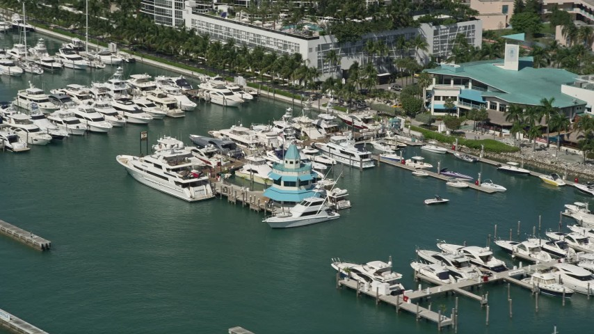 5K stock footage aerial video fly by yachts, fishing boats, Miami Beach Marina, South Beach, Florida Aerial Stock Footage | AX0031_048