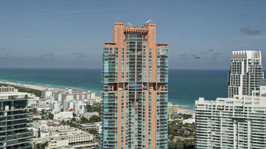 5K stock footage aerial video of flying by Portofino Tower, South Beach, Miami Beach, Florida Aerial Stock Footage | AX0031_049