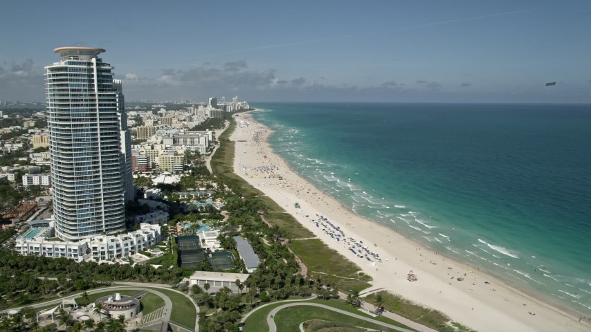 5K stock footage aerial video of flying by the beach along the coast, South Beach, Miami Beach, Florida Aerial Stock Footage | AX0031_050