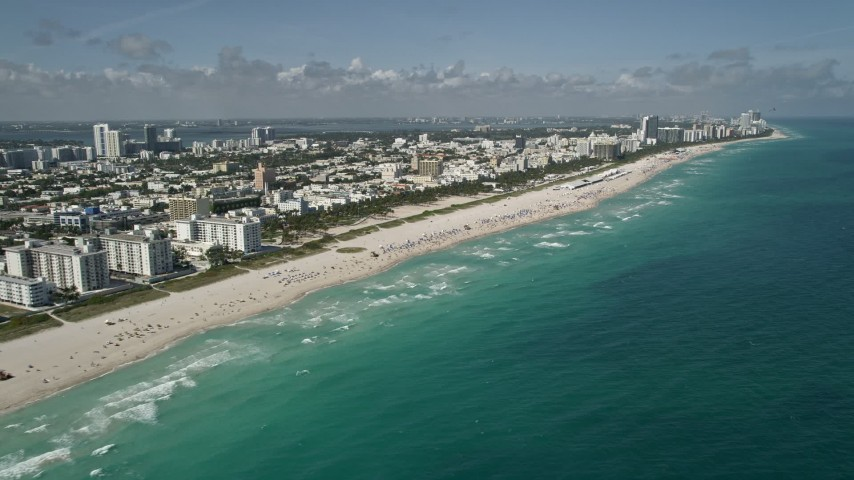 5K stock footage aerial video of flying by the beach South Beach, Miami Beach, Florida Aerial Stock Footage | AX0031_051