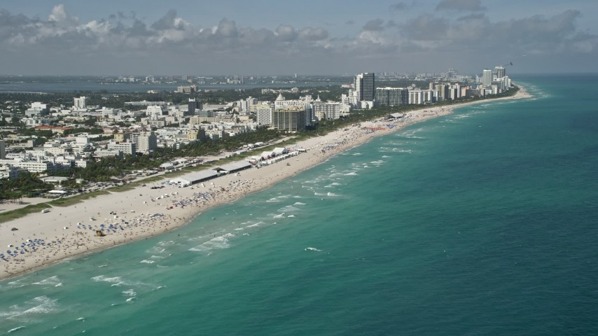 Flying by the beach, South Beach, Miami Beach, Florida Aerial Stock Footage AX0031_052