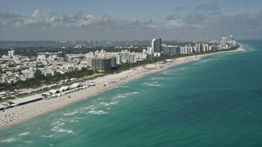5K aerial video of flying by the beach, South Beach, Miami Beach, Florida Aerial Stock Footage AX0031_052