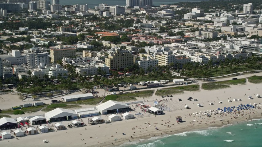 5K stock footage aerial video of flying by sunbathers on the beach, South Beach, Miami Beach, Florida Aerial Stock Footage | AX0031_053