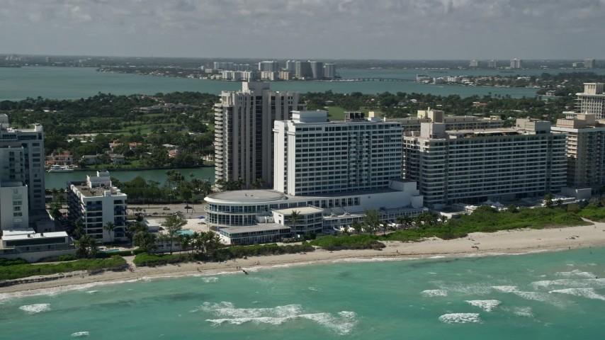 5K stock footage aerial video of condominium complex on the beach, Miami Beach, Florida Aerial Stock Footage | AX0031_062